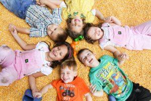 Amazing Grace Family Farm kids in corn